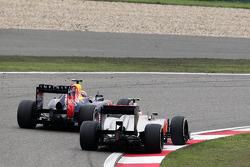 Mark Webber, Red Bull Racing leads Lewis Hamilton, McLaren