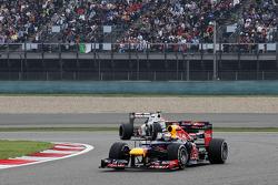 Sebastian Vettel, Red Bull Racing leads Sergio Perez, Sauber
