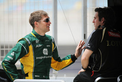 Vitaly Petrov, Caterham F1 Team with a former Lotus team colleague