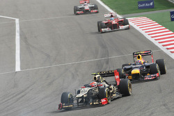 Romain Grosjean, Lotus F1 leads Mark Webber, Red Bull Racing