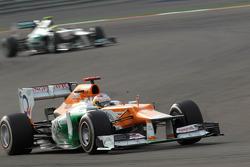 Paul di Resta, Sahara Force India Formula One Team leads Nico Rosberg, Mercedes AMG Petronas