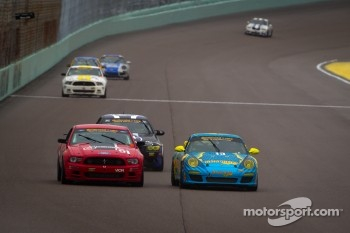 #13 Rum Bum Racing Porsche Carrera: Nick Longhi, Matt Plumb passes #51 Roush Performance Mustang Boss 302R: Shelby Blackstock, Jade Buford