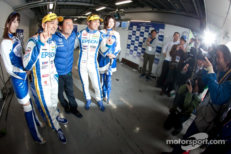 GT500 pole winners Ryo Michigami and Yuki Nakayama celebrate with Satoru Nakajima
