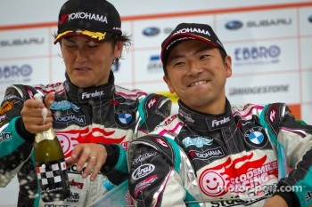 GT300 podium: winners Nobuteru Taniguchi and Tatsuya Kataoka
