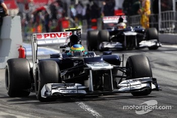 Bruno Senna, Williams and team mate Pastor Maldonado, Williams leave the pits