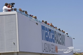 Race fans enjoying action from Ferrari 458 Challenge race