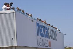 Race fans enjoying action from Ferrari 458 Challenge race