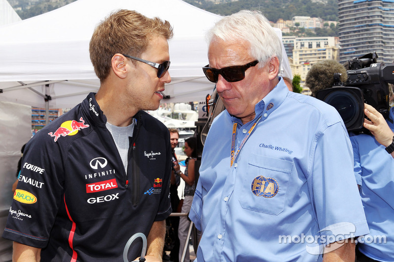 Sebastian Vettel, Red Bull Racing with Charlie Whiting, FIA Delegate