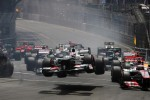 Kamui Kobayashi, Sauber flies through the air at the start of the race as he crashed with Romain Grosjean, Lotus F1