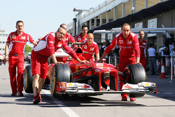 The Ferrari of Felipe Massa, Scuderia Ferrari is pushed along the pit lane