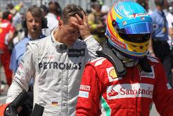 Michael Schumacher, Mercedes AMG Petronas and Fernando Alonso, Scuderia Ferrari
