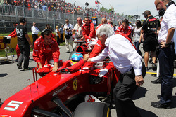 Fernando Alonso, Scuderia Ferrari and Bernie Ecclestone, CEO Formula One Group, on the grid