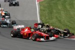 Romain Grosjean, Lotus F1 Team and Felipe Massa, Scuderia Ferrari
