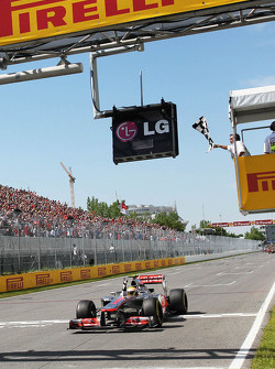 Race winner Lewis Hamilton, McLaren Mercedes takes the chequered flag at the end of the race