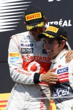 The podium, Lewis Hamilton, McLaren Mercedes with Sergio Perez, Sauber