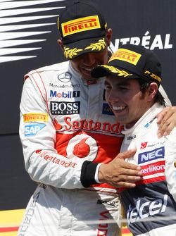 The podium, Lewis Hamilton, McLaren Mercedes with Sergio Perez, Sauber