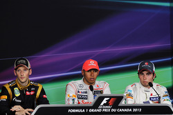 Post race FIA Press Conference Romain Grosjean, Lotus F1 Team, second; Lewis Hamilton, McLaren Mercedes, race winner; Sergio Perez, Sauber, third