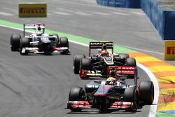 Lewis Hamilton, McLaren Mercedes leads Romain Grosjean, Lotus F1 and Kamui Kobayashi, Sauber