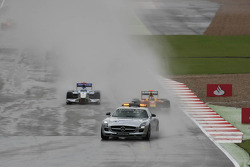 The safety car leads the grid