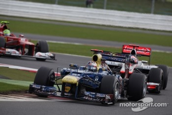Sebastian Vettel, Red Bull Racing leads Jenson Button, McLaren Mercedes