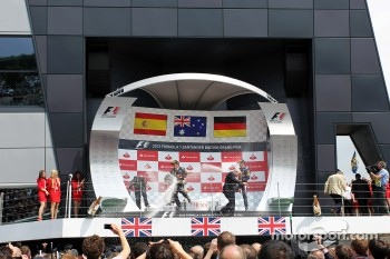 Race winner Mark Webber, Red Bull Racing and Sebastian Vettel, Red Bull Racing celebrate on the podium