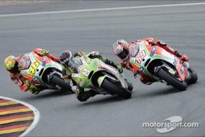 Battle between Hector Barbera, Pramac Racing Team and Nicky Hayden, Ducati Marlboro Team and Valentino Rossi, Ducati Marlboro Team