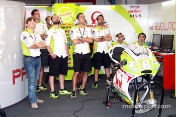 The Pramac team looks on