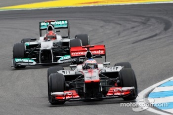 Jenson Button, McLaren leads Michael Schumacher, Mercedes AMG F1