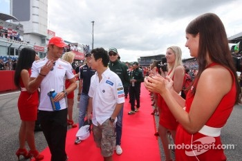 Jenson Button, McLaren Mercedes and Kamui Kobayashi, Sauber F1 Team