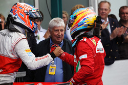 Race winner Fernando Alonso, Ferrari celebrates in parc ferme with Jenson Button, McLaren