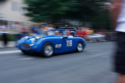 Race cars leave Elkhart Lake after the Friday Concours.  #119 1960 Austin Healy Sprite: Terry Davis
