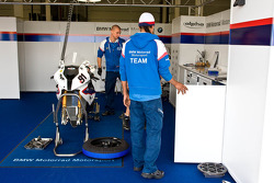Mechanics work on the bike