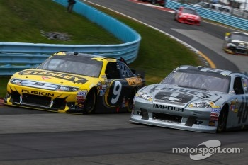 Marcos Ambrose, Richard Petty Motorsports Ford  - Jimmie Johnson, Hendrick Motorsports Chevrolet