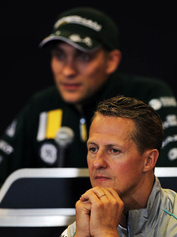 Michael Schumacher, Mercedes AMG F1 and Vitaly Petrov, Caterham in the FIA Press Conference
