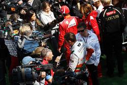 Paul di Resta, Sahara Force India F1 and Fernando Alonso, Ferrari with the media