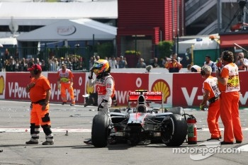 Lewis Hamilton, McLaren after he was involved in a crash at the start