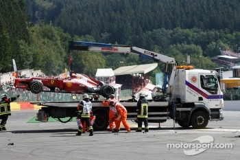 The Ferrari of Fernando Alonso, Ferrari is craned away after a crash at the start