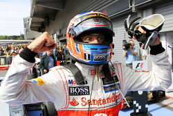 Race winner Jenson Button celebrates