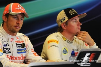 Race winner Jenson Button, McLaren and Kimi Raikkonen, Lotus F1 Team in the FIA Press Conference
