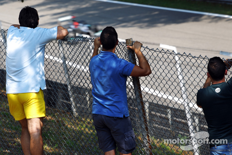 Fans watch Michael Schumacher, Mercedes AMG F1