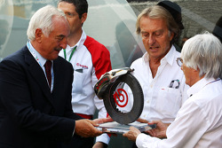 F1: Alberto Bombassei, Brembo CEO presents Bernie Ecclestone, CEO Formula One Group, with a special Brembo brake to commemorate the 50th anniversary of the company