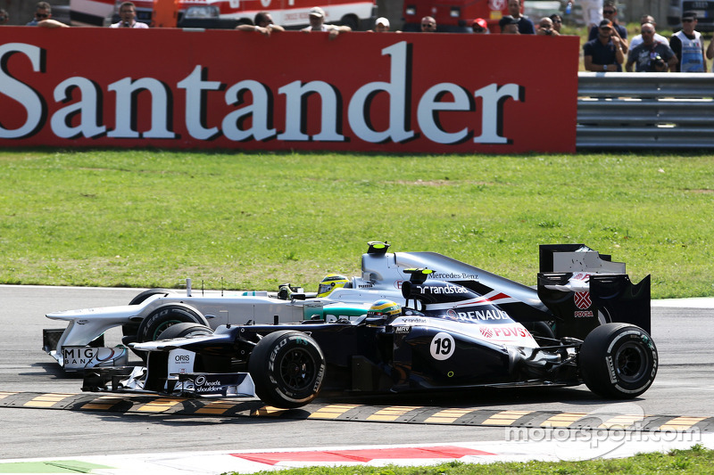 Nico Rosberg, Mercedes AMG F1 and Bruno Senna, Williams battle for position