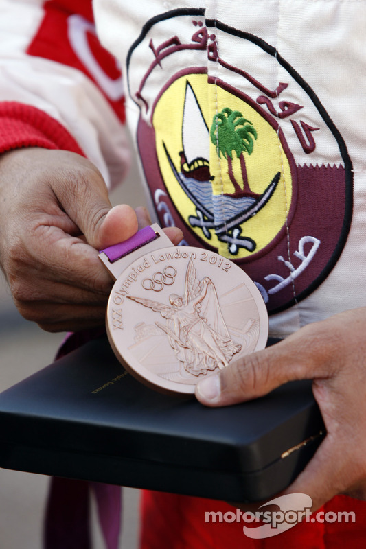 Nasser Al-Attiyah shows off his London Olympic Bronze medal he won in shooting