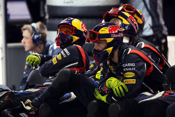 Red Bull Racing mechanics watch the race