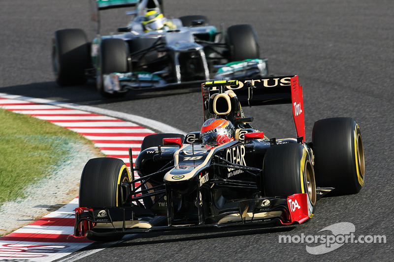 Romain Grosjean, Lotus F1 leads Nico Rosberg, Mercedes AMG F1