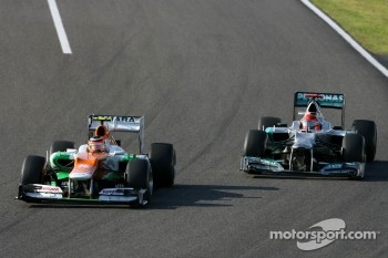 Nico Hulkenberg, Sahara Force India Formula One Team and Michael Schumacher, Mercedes GP