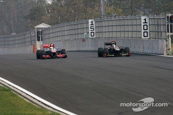 Lewis Hamilton, McLaren Mercedes and Kimi Raikkonen, Lotus F1 Team