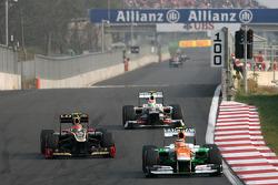 Romain Grosjean, Lotus F1 Team and Nico Hulkenberg, Sahara Force India Formula One Team