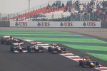 Lewis Hamilton, McLaren, Jenson Button, McLaren and Fernando Alonso, Ferrari battle for position behind Mark Webber, Red Bull Racing