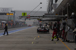 Pit lane at the start of a damp practice #3